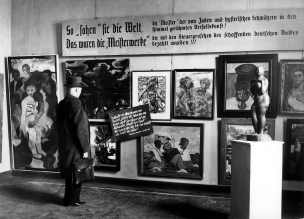 A man looks at pieces from Nazi-curated travelling exhibition 'Degenerate Art' at the Haus der Kunst in Berlin